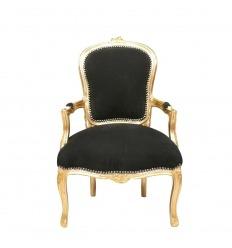 Sillón Luis XV en madera negra y dorada.