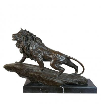 Statue en bronze d'un lion sur un rocher - Animaux en bronze -