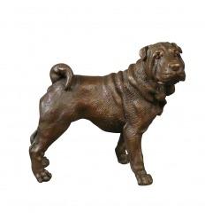 Estatua de bronce de un perro.