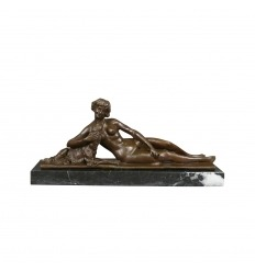 Bronze statue of a nude woman lying
