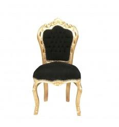 Silla barroca negra y dorada.