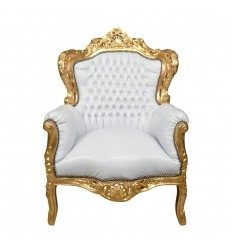 Sillón barroco blanco y dorado.