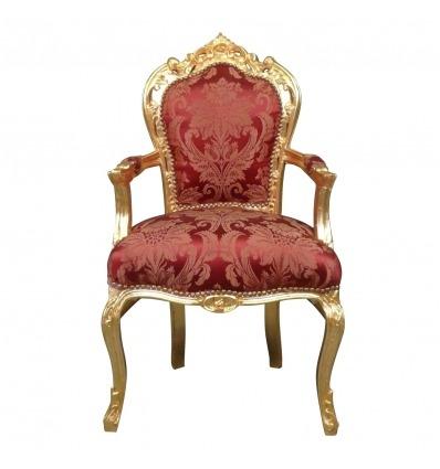 Fotel w stylu barokowym, pozłacane i czerwona tkanina w stylu rokoko -