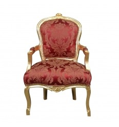 Red armchair in gilded wood in the Louis XV style