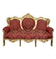 Sofá barroco rojo y dorado.
