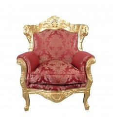 Sillón barroco en madera dorada y tejido rojo rococó.