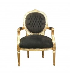 Louis XVI black armchair and gilded wood