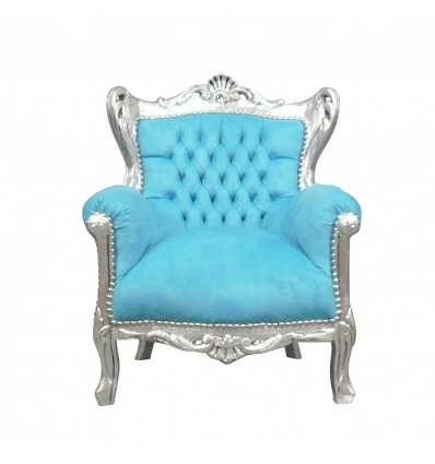 Sillón barroco azul y plata y muebles de estilo. -