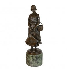 Bronze statue - The woman in basket