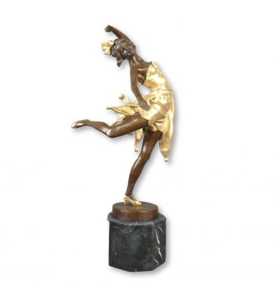 Statua in bronzo art deco ballerino a patina marrone e oro -