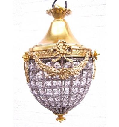 Araña en bronce y cristales estilo Luis XVI.